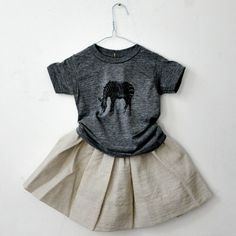 I love the play of the graphic t-shirt with the linen skirt. Cute!