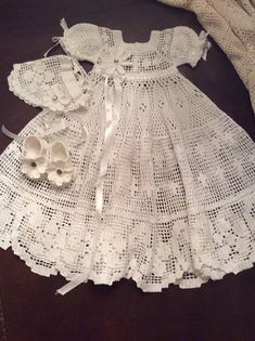 Im very excited to introduce this pattern for a beautiful christening gown that will definitely be one if your favorites. It is done in a filet crochet style. The gown itself will take about 60 hours to complete. The bonnet will take about 3 hours to finish and the sandals will take