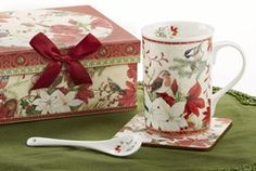A Victorian Santa themed mug, spoon and coaster is the perfect gift for the person who has everything.  Whether it is a coworker, or special friend, they will enjoy this set depicting Victorian styled beautifully packaged in a matching box with a red ribbon, all ready for gift giving.  Make your gift buying easier this year with this elegant set.