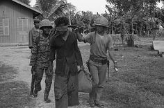 Rise and Fall of Khmer Rouge.    Losing Control  A Cambodian soldier holds a .45 to the head of a Khmer Rouge suspect in 1973. When Sihanouk was forced out of power in a coup, the new Prime Minister, General Lon Nol, sent the army to fight the North Vietnamese and the Khmer Rouge in Cambodia. Fighting two enemies proved to be too much for Cambodia's army. As Civil War raged from 1970 to 1975, the army gradually lost territory as Khmer Rouge increased its control in the countryside.