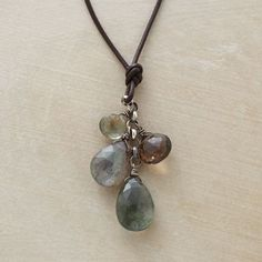 FORESTRY NECKLACE -- Woodsy hues of moss aquamarine, smoky quartz and labradorite sprout from a knotted strand of brown leather. Sterling silver links