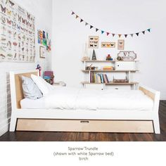 Oeuf Sparrow Bed.  See if Trundle fits normal twin.
