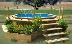 Impressive Backyard Design And Decoration With Various Above Ground Pool Deck Ideas : Beautiful Picture Of Backyard Landscaping Decoration Using Round Above Ground Pool Deck Including Small Oak Wood Pool Staircase And Solid Oak Wood Rope Pool Fence Above Ground Pool Landscaping, Swimming Pool Landscaping, Backyard Landscaping, Pool Fence, Backyard Ideas, Landscaping Ideas, Fence Ideas, Round Above Ground Pool, Above Ground Swimming Pools