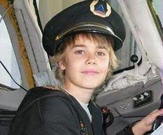 Little Biebs wearing a Delta pilot hat. Adorbs.