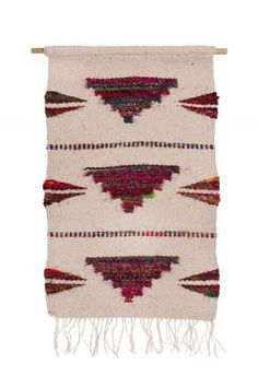 "The Moving Forward Wall Hanging is a meaningful gift for someone spending Christmas in a new home. This eco‒friendly wall hanging is handcrafted from recycled silk by artisans working with our fair trade partner Manushi in Nepal. Translating to mean, ""energetic woman,"" Manushi empowers women to take charge of their own lives through sustainable employment and financial independence."