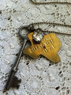 Vintage 1968 Texas Dog Tag with Skeleton Key and a Little Bling - ONLY ONE LEFT. $26.00, via Etsy.