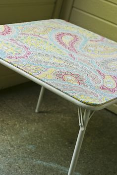 Refurbish your card table. Just pick a dollar store table cloth that matches your home decor.