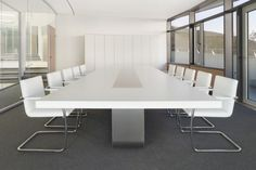 This white boardroom table would offset the black ceiling and brighten the room while being highly functional with just the 2 wide grey legs in the middle.