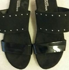 White Mountain black wedges Black patent leather and fabric make up this summer wedge. Wide elastic, with decorative rivets, make up the wide strap. The bottom strap is patent leather. White Mountain  Shoes Wedges