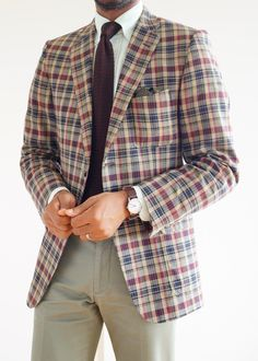 Plaid jacket, white shirt with light green dress stripes, brown knit tie, olive khakis