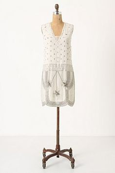 Similar to the dress that Marion Cotillard wears at Woody Allen's film, Midnight in Paris