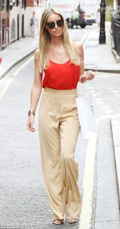 Her high waisted pants help emphasize her legs by making them look longer and making her look taller.