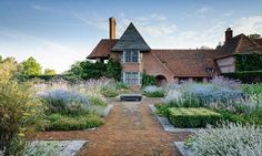 Folly Farm, the historic property designed by architect Sir Edwin Lutyens, and with gardens designed by Gertrude Jekyll. Gardens redeveloped by Dan Pearson.
