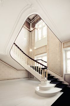 The neo-classical frame of the building is evident in the staircases, doorways and gold-painted accents and friezes.   Tuija Seipell Architect and designer Helle Flou, founder of Copenhagen-based HelleFlou, was responsible for the design of the offices for the Danish Fashion and Textile association (Dansk Mode og Textil) and Kopenhagen Fur.