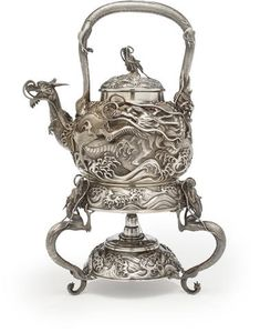 A large silver teapot, burner and stand By the Konoike workshop, Meiji period (late 19th century)