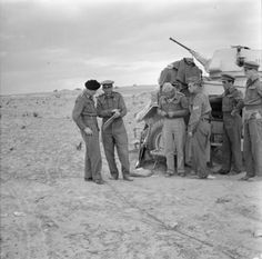 General Montgomery with other officers planning the final assault on Tripoli beside a Humber Mk II armoured car, 22 January 1943.