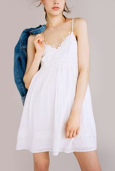The delicate floral texture on this Topshop babydoll dress makes it so feminine and romantic.