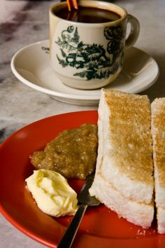 Malaysian Food: A classic Hainanese coffeeshop breakfast: coffee and charcoal-grilled toast with butter and kaya, usually accompanied by a soft-boiled egg. I wouldn't mind trying that. Taken by David Hagerman,.