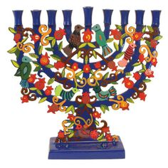 This gorgeous Painted Metal Laser Cut Hanukkah Menorah is a spectacular addition to Hanukkah ceremonies in your Jewish home. The tasteful design combines a classical menorah, upon which the candles are placed, as well as vivid designs of birds, leaves, fl Jewish Menorah, Hanukkah Menorah, Hanukkah Gifts, Happy Hanukkah, Jewish Hanukkah, Hanukkah Blessings, Arte Judaica, Hanukkah Candles, Hanukkah Decorations