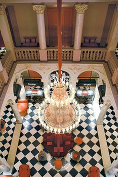 Lobby and hall, tiles in checkboard black and white with magnificent Chandelier at the Hotel de la Paix Geneva in Switzerland | Flickr - Photo Sharing!