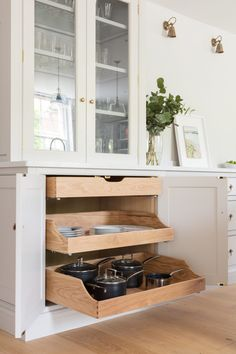 Swan neck drawers are an integral part of many of our kitchen projects where client want to maximise every last drop of easy-access storage in their kitchen. Hidden behind what looks like a regular double cupboard door, the swan neck drawers slide out to reveal a tidy way to store a multitude of different items. Depending on the area of the kitchen and what you like to cook most swan neck drawers are ideal to be used as baking storage, pots and pans, tableware, even food. #humphreymunsonblog