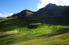 7 Places That Could Be Confused for Heaven on Earth - Green Fields on Kalsoy, Faroe Islands: The Green Fields located on Kalsoy, Faroe Islands in the Kingdom of Denmark are one of nature's best gifts. The flat green fields surrounded by rocky hills just remind you of 'Wizard of Oz' where Dorothy lived. This may just be our retirement retreat one day!