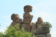 Balancing rocks are visited by tourists in Zimbabwe. The stacked rocks curious tourists by wondering why they're stacked, how ancient people did it with their technology, and they're amazed that they're still standing today. Balanced Rock, Ancient Ruins, Still Standing, Places Of Interest, Zimbabwe, Geology, Mount Rushmore, Garden Sculpture, Tourism
