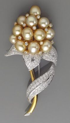 A cultured pearl, diamond and eighteen karat gold brooch