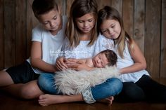 newborn baby with 3 siblings | newborn studio portraiture | greensboro newborn photographer | heather mcginnis photography
