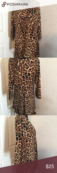 Chico's leopard print top size 3 regular size 16. Chico's leopard print top size 3 regular size 16. This is a gorgeous top with baby doll waist. It is long enough to wear with leggings and boots. It is in great shape. Please view all pictures. Chico's Tops Blouses