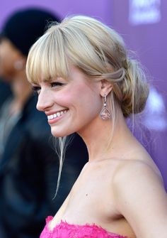 The actress coupled her blunt bangs with a low-slung chignon.