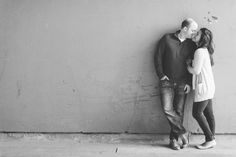A couple leans against a wall at High Line Park during their engagement session with NYC wedding photographer Ben Lau.