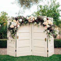 vintage door and floral garland backdrop