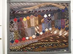 Quilt Expo Beaujolais in 2013 .. looks like it's made of mens ties.