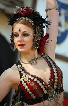 The very first act I checked out at the Texas Renaissance Fair (TRF) in November 2010 was a belly dance troupe called Shunyata - and wow, they were very good. Three dancers accompanied by three musicians. They put on a great show, but it was very tough to shoot from a photographic perspective - too much dappled lighting (sun/shade mix). Oh well, I guess I have to return to Plantersville in 2011 to try my luck again!