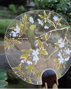 This is a beautiful example of an Uchiwa, a traditional Japanese fan