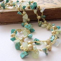 Gold silk thread, hand knitted with turquoise lovely chips and mint green jade chips.
