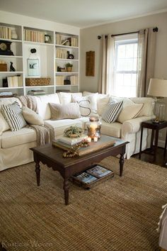 Cottage-style-living-room-with-Pottery-Barn-sectional-and-vintage-accents.-Rustic-&-Woven