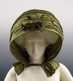 Silk Calash from 1790. In the 1770s, when huge wigs and hairstyles were fashionable, the 'calash' bonnet was worn to protect the high hairstyles from the weather. These collapsible bonnets were made of strips of wood or whalebone sewn into channels of a silk hood. A long ribbon attached to the top front of the hood, held firmly in the hand, allowed the wearer to hold the calash securely, while walking in the wind, rain, and snow....POP SHADES