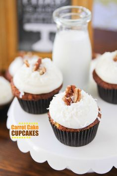 Carrot Cake Cupcakes loaded with pineapple, coconut and pecans and topped with pineapple cream cheese frosting!