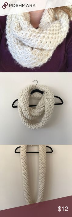 CHUNKY HONEYCOMB KNITTED INFINITY SCARF Very cozy chunky cream colored honeycomb knitted infinity scarf. Perfect for really cold days on the run.   From a smoke and pet free home.  Measurements upon request. Accessories Scarves & Wraps