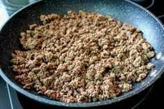Ground beef browning in a saute pan.