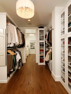 Harry Braswell Inc: Glamorous closet design with Claremont White Nickel Chandelier. Wall to wall storage, ...
