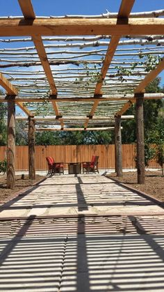 Utility pole pergola finished with aspen trees