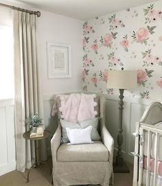 Beautiful Nursery with large floral wallpaper and wainscoting