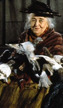 The Birdwoman (Jane Darwell) from Mary Poppins. ------ah, my favourite scene (and song) in the movie. Although it's Disney, the setting is supposedly London....at least it's London in the books. ;)