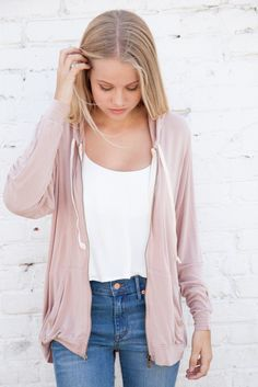 Simple White Blouse. Light pink hoodie. High waisted boyfriend jeans Brandy Melville