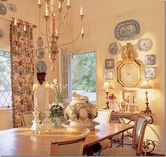Charles Faudree's collection of blue and white porcelains hang surrounded by an antique French barometer.