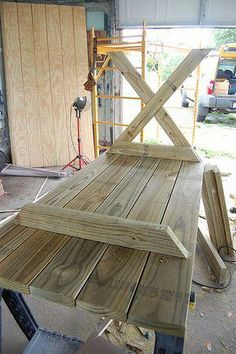 DIY X frame table #WoodworkingFurniturePopularMechanics Diy Picnic Table, Picnic Table Plans, Diy Outdoor Table, Diy Outdoor Furniture, Diy Furniture, Diy Garden Table, Deck Table, Patio Tables, Diy Dining Table