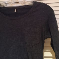 Dark gray long sleeve Very comfortable. Side pocket on front left. Barely worn great condition Tops Tees - Long Sleeve